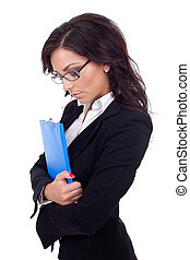 Upset business woman holding a clipboard
