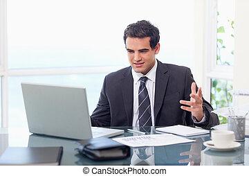 Upset businessman working