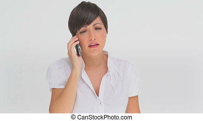 Upset businesswoman on the phone