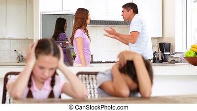 Upset children listening to their parents