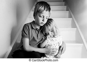 Upset children - Upset Brother comforting his baby sister.