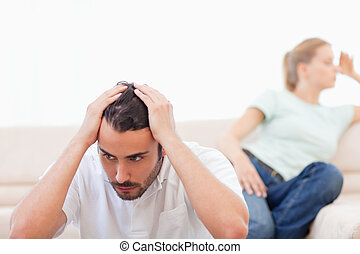 Upset couple mad at each other in their living room