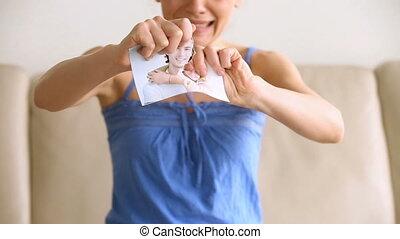 Upset desperate woman crying, teenage girl tearing photo, breakup concept