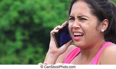 Upset Female Teen Listening To Cell Phone