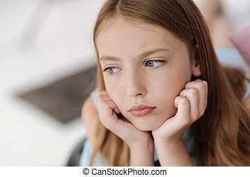 Upset female youngster looking into vacancy - Sad times. Not...