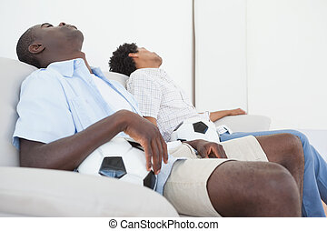 Upset football fans sitting back on couch