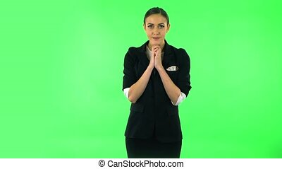 Upset girl looking at the camera with tears in her eyes. Green screen