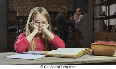 Upset girl studying while her parents fighting - Upset teen...