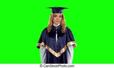 Upset graduate threatens finger. Green screen. Slow motion
