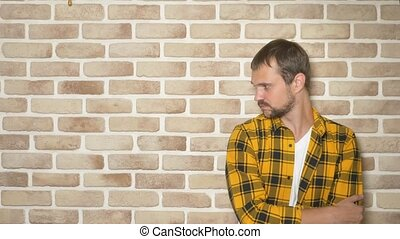 upset handsome man in a fashionably yellow checkered shirt ...