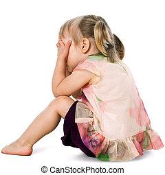 Upset kid hiding face with hands. - Portrait of upset little...