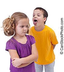 Upset little girl bullied by older boy