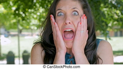 Upset mad furious woman screaming out loud outside - Upset...
