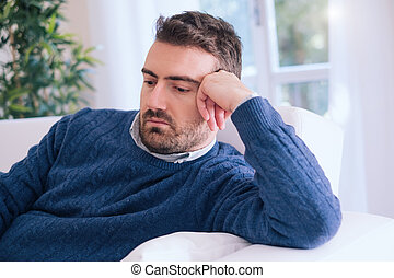 Upset man feeling negative emotions at home