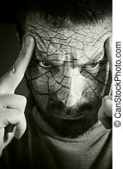 Upset man with cracked skin