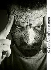 Upset man with cracked skin