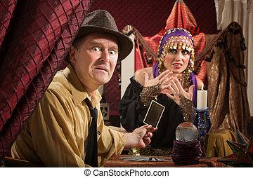 Upset Man with Tarot Cards