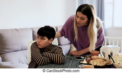 Upset mother and offended son arguing in domestic interior