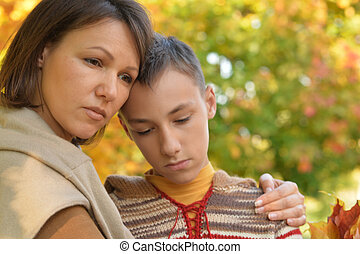 upset mother with son portrait