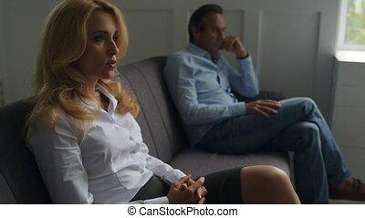 Upset pair having a talk with psychologist