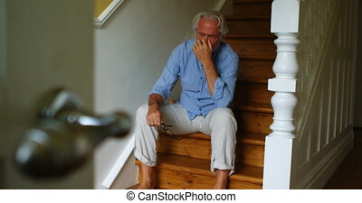 Upset senior man sitting on stairs 4k - Upset senior man...