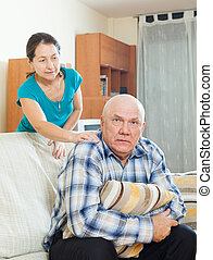 Upset senior man with  wife at home