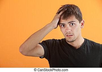 Upset Teen - Upset Hispanic teen male with hand on head