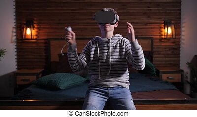 Upset teenager losing while playing in VR game - Annoyed ...