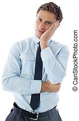 Upset thinking businessman on white background