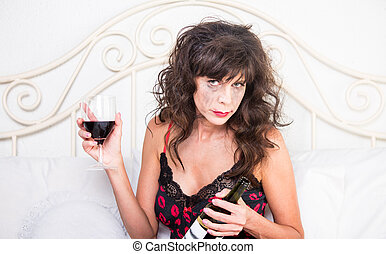 Upset Woman Drinking Wine in Bedroom