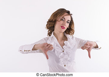 Upset woman giving thumbs down gesture on a white background