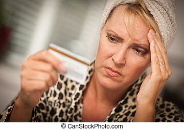 Upset Woman Holding Her Credit Card - Woman Obviously Very...