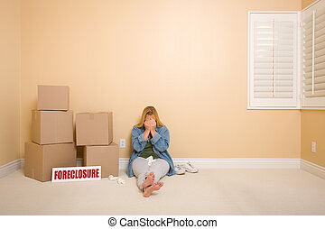 Upset Woman on Floor Next to Boxes and Foreclosure Sign -...