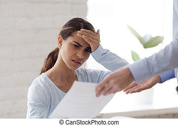 Upset woman receiving bad news, dismissal notice, document