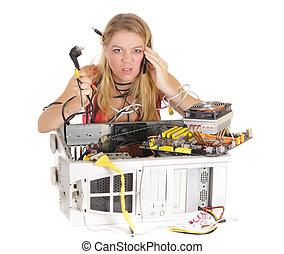 upset woman repairing computer
