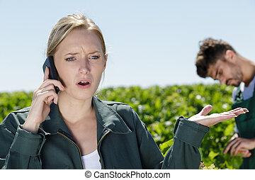 upset woman talking on telephone