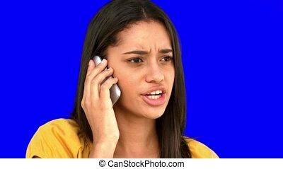 Upset woman talking on the phone on