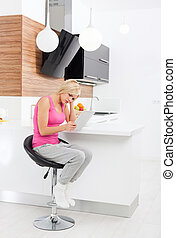 upset woman using tablet computer at home unhappy