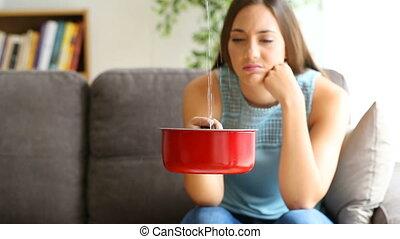 Upset woman watching home leaks