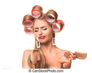 Upset woman with hair curlers on her head over white background
