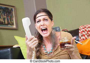 Upset Woman Yelling Into Phone