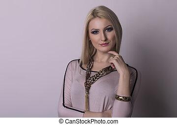 Upset young blonde woman. Studio shot