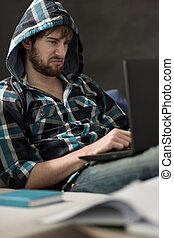 Upset young man with laptop