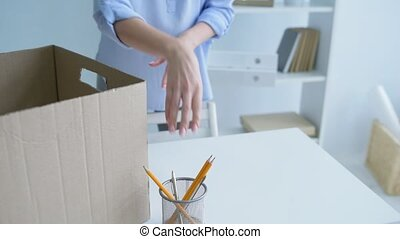 Upset young woman packing stuff while quitting office - Had...
