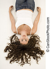 Upside Down 3 - An attractive young woman lies on her back...