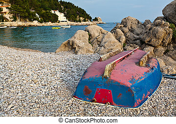 Upside Down Boat on the Rocky Beach in Croatia