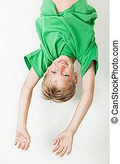 Upside down boy in green shirt