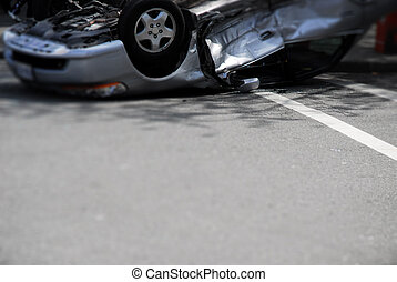 Upside-down Car Crash - A silver car, upside-down after a...