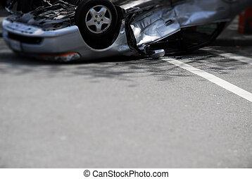 Upside-down Car Crash - A silver car, upside-down after a...