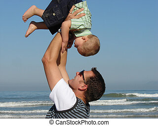 Upside Down - Father picking up his son high into the air.